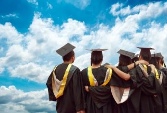36302493 - back of chinese graduates with blue sky